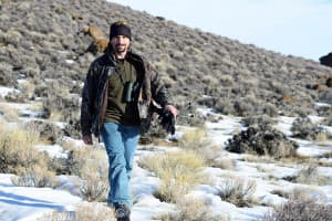 Mark Dantzker walks across the sagebrush while working on a documentary about sage grouse. (Courtesy Gerrit Vyn)