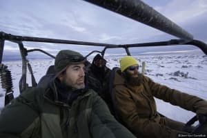 "Gerrit Vyn, principle videographer (left), and Marc Dantzker, producer ride with assistant Jamie Drysdale while working on the film ""Sagebrush Sea."" (Courtesy Gerrit Vyn)"