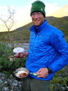 Chris Scovil, of Chicago, shows off his culinary skills while on a NOLS course in the Brooks Range in Alaska. (courtesy Shelli Johnson)