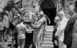 The casket of U.S. Senator Lester Hunt of Wyoming is carried out of a church, following his suicide and political persecution stemming from anti-gay sentiments in the 1950s.
