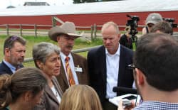 Interior Secretary Sally Jewell and Wyoming Gov. Matt Mead answer questions from the press at an event announcing the release of 14 Bureau of Land Management Environmental Impact Statements covering changes to 98 Resource Management Plans across 10 western states to advance conservation of the greater sage-grouse. Wyoming's Sage Grouse Implementation Team leader Bob Budd stands at center in cowboy hat. (USFWS)