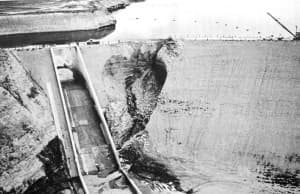 "Fontenelle Dam almost failed soon after it was built and filled in 1965, but emergency action saved the day. After that, the Bureau of Reclamation used 203,500 sacks of cement to stop ""piping"" leaks that created the sinkhole, according to a presentation by University of Missouri-Rolla Geology and Engineering Department Chairman Karl F. Hasselmann and others. (University of Missouri)"