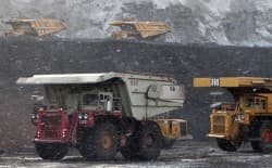 Trucks in the foreground wait to be loaded with coal in this 2009 photo from Belle Ayr mine, operated by Alpha Natural Resources. The Wyoming Department of Environmental Quality recently asked Alpha to prove that it can pay for reclamation. (Dustin Bleizeffer/WyoFile)