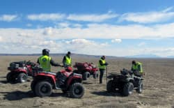 CAPTION: Power Company of Wyoming's engineering consulting team uses all-terrain vehicles to cross the massive Overland Trail Ranch and locate the future sites of 1,000 wind turbines. The effort is necessary to site turbines away from sage grouse breeding grounds, nests and other sensitive habitat. (courtesy of Power Company of Wyoming)