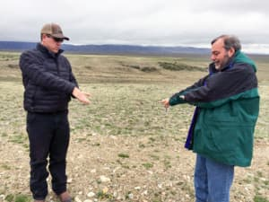 Garry Miller, a vice president with Power Company of Wyoming LLC, right, and Jon Kehmeier, an ecologist hired by the company, describe how strong winds moving over the hills at the Overland Trail Ranch will drive wind turbines across the prairie. Photo by Scott Streater.
