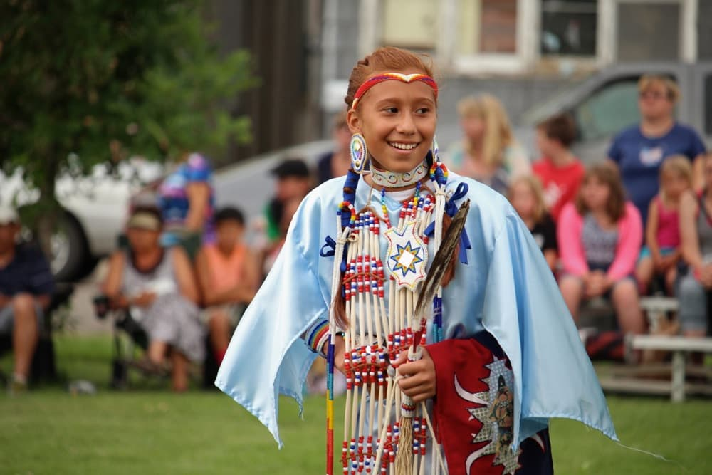 Tayler Factor (Seminole) of Lame Deer, Montana, smiles between dances at the First People's Powwow at the Sheridan Inn on Thursday. (Gregory Nickerson/WyoFile)