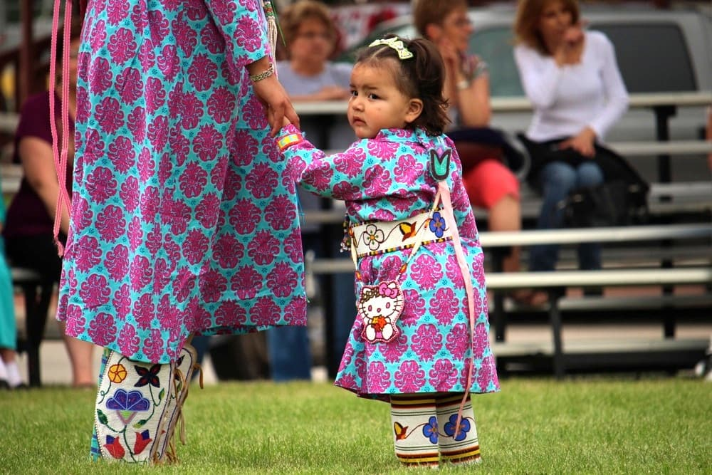 Tayzlee Other Medicine (Crow), age 1 of Crow Agency, Montana, dances with her mother at the First People's Powwow at the Sheridan Inn on Thursday. (Gregory Nickerson/WyoFile)