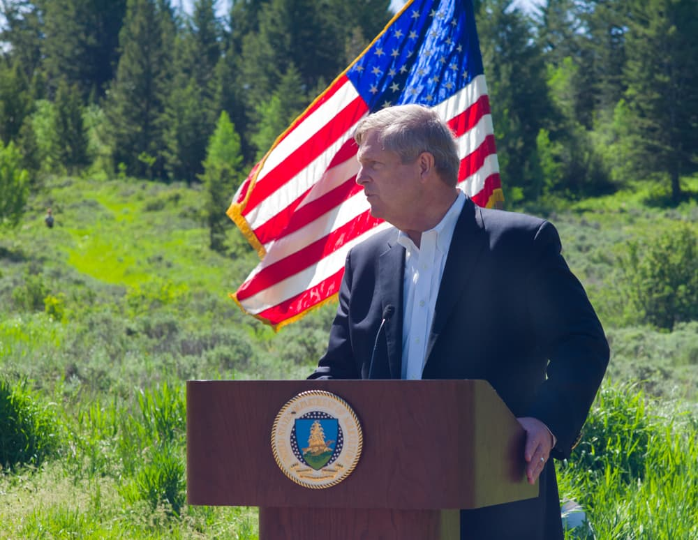 U.S. Secretary of Agriculture Tom Vilsack addresses trail workers in Jackson on Thursday as called on Congress for a better funding source for firefighting. The current system frequently eats into the U.S. Forest Service budget and prevents the agency from doing its job, he said. (Angus M. Thuermer Jr./WyoFile)