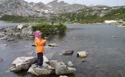 A girl fishes in a small lake in the Wind River Range in 2010, about 10 miles away from the nearest trailhead. Recreation and conservation groups say they didn't have enough opportunity to ask for site-specific examples of waters that should be excluded from the state's recent downgrade in E. coli standards. (courtesy Wyoming Outdoor Council)