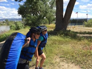 Christine Peterson and Kelsey Dayton finish Casper Strong July 12. The race finishes with a float through the Casper whitewater park and down the river. (courtesy Josh Peterson)