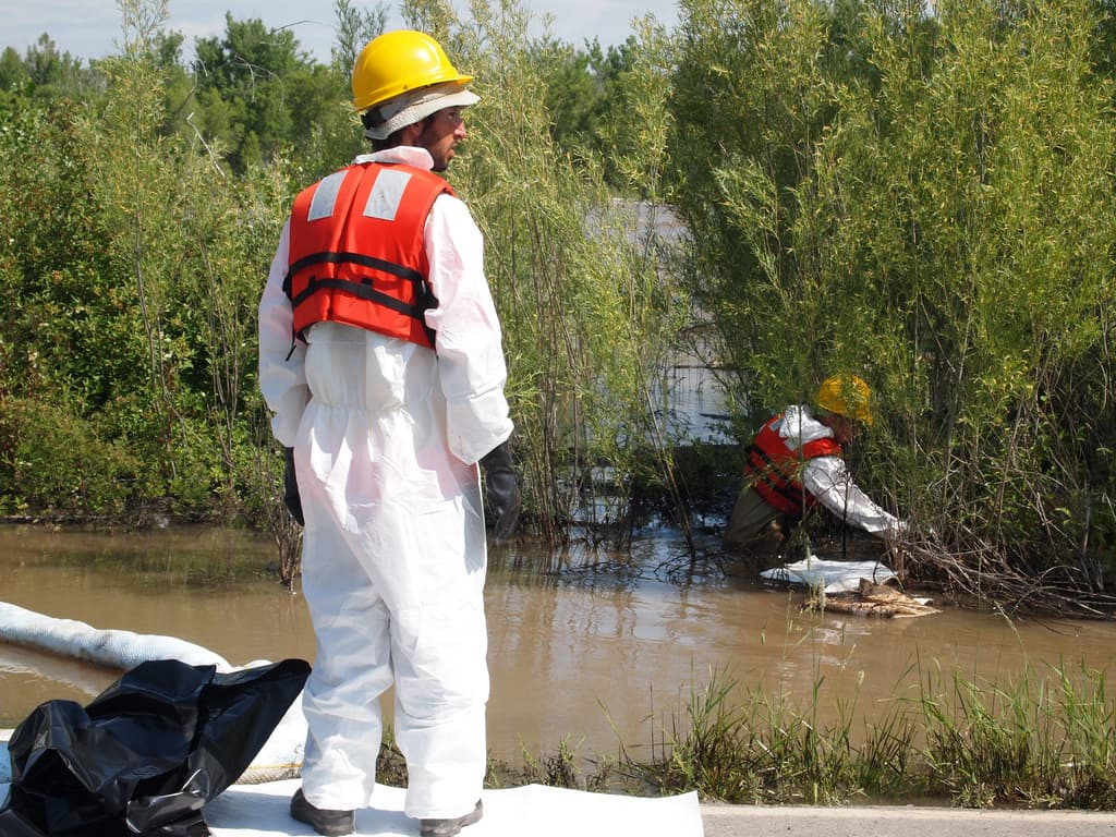 Contractors wore hazmat suits during cleanup efforts for the 2011 Silvertip spill along Thiel Rd in Laurel, MT. (Tom Bearden/Flickr Creative Commons)