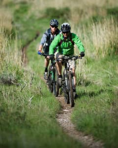 Mountain bikers ride a trail near Jackson. (courtesy Doug Ayers)