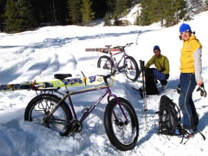 Scott and Jannine Fitzgerald use fat bikes to access a backcountry ski in Teton Canyon near Alta, Wyoming. (courtesy Tim Young)