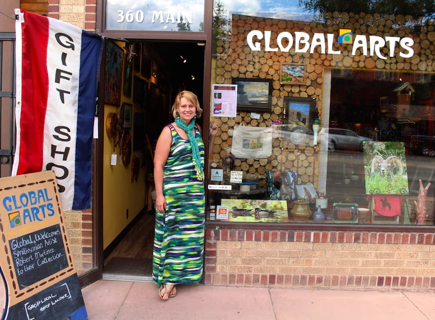 Noelle Weimann van Dijk stands outside the Global Arts gallery she and her husband Feike purchased on Main Street in Lander this spring. Money raised through GoFundMe and other sources helped her family get back on their feet after a period of unemployment. (Gregory Nickerson/WyoFile)