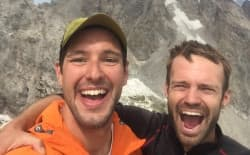 Ryan Burke (right) celebrates with Taylor Luneau on top of Nez Perce, officially marking the end of the Grand Traverse. Burke continued on the next day climbing several more peaks as part of the four-day venture he calls the Perception Traverse. Luneau spent two of the four days with Burke in sections he needed ropes. (courtesy Taylor Luneau)