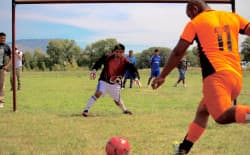 Goalkeeper Kenyu Martinez Chuco prepares to block a kick from Efren Sanchez at the 2015 Little Snake River soccer games, a tournament hosted by the pioneer Cobb family as a tribute for foreign H-2A visa workers. The tournament is one of the largest of its kind in the region, attracting teams from Wyoming, Colorado, and Utah. (Gregory Nickerson/WyoFile)