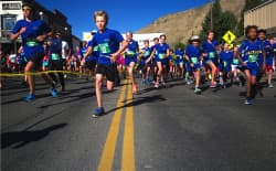 Runners take off from the start at Old Bill's Fun Run for Charities in Jackson  on Sept. 12, the annual fundraiser for the Jackson Hole Community Foundation. In 18 years the event has raised more than $111 million. Last year 3,230 donors gave a total of $10.4 million to feed the hungry, house homeless pets, teach children, protect the environment and aid other causes. (Angus M. Thuermer Jr./WyoFile)