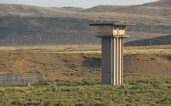 A guard tower at the Wyoming State Penitentiary outside Rawlins stands as a symbol of tough sentencing practices. Sentencing reform could reduce costs and get those who really need to be locked up off the streets, former Wyoming ACLU head Linda Burt says. (Gregory Nickerson/WyoFile)