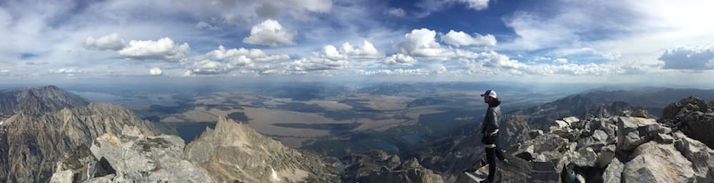 Ryan Burke looks out from the summit of the Grand Teton. (courtesy Taylor Luneau)