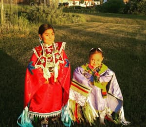 "Amarie Swallow (right) in her jingle dress. Children on the Wind River Indian Reservation face obstacles to health care, which can determine their ""life course."" (photo by Matthew Copeland/WyoFile)"