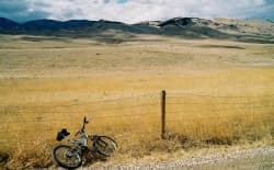 """A bike is left at the bus stop somewhere south of Buffalo, Wyo.  (by """"lord the air smells good today,"""" creative commons)"""