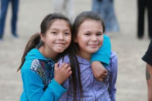 Two young girls enjoying the Norther Arapahoe horse culture program in June. (courtesy HHS Office of Minority Health)