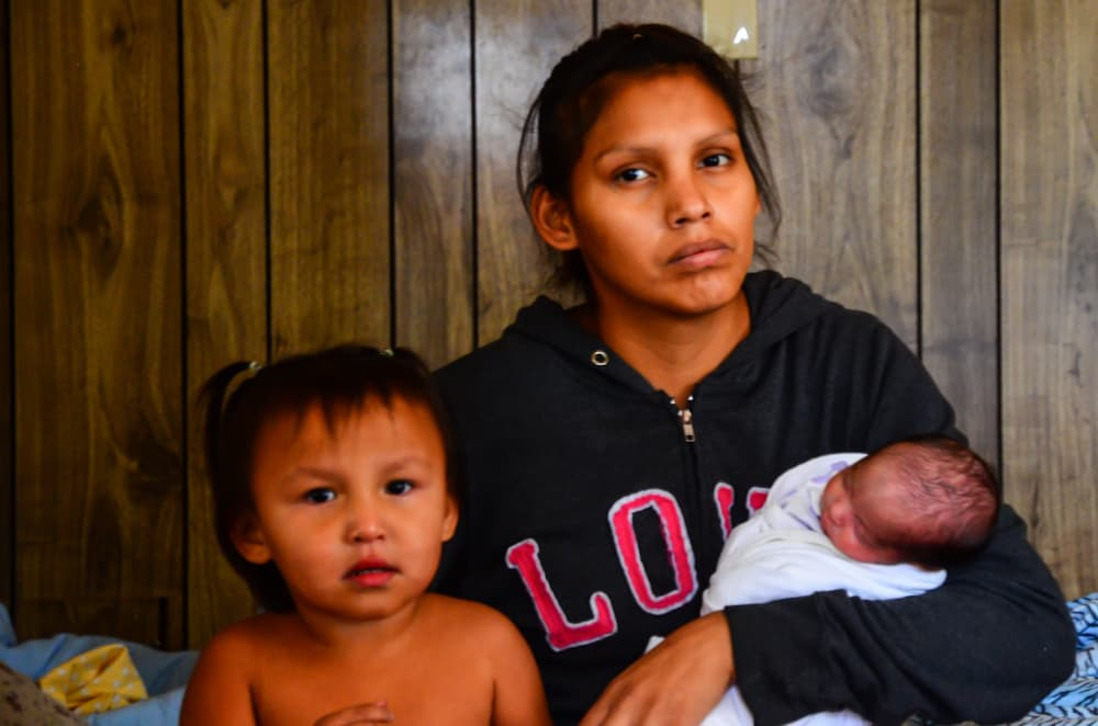 Tanisha Oldman with two of her three young children. Oldman is determined to provide her kids with more opportunity than she had. (Matthew Copeland/WyoFile)