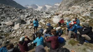 Central Wyoming College students attend class on ice-mass balance at the terminal moraine of the Dinwoody Glacier. Visiting scholar Sarah Konrad from the University of Wyoming delivers the briefing. (photo by Kyle Nicholoff)