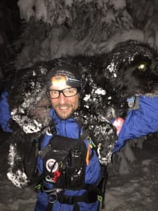 Jake Urban carries a dog during a training exercise with Teton County Search and Rescue. (courtesy Teton County Search and Rescue)
