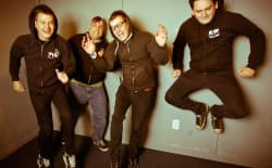 Wyoming rockers Ray Carlisle (far left), Kody Templeman, Brandon Carlisle, and Miguel Chen, of Teenage Bottlerocket in Denver in April 2011 during a WyoFile interview. Earlier this week we learned Brandon was in a coma and fighting for his life. Thousands of friends from Wyoming and from around the world were hoping for Brandon to pull through. He lost the battle and died on Saturday. (Brad Christensen/WyoFile — click to enlarge)