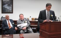 President of the Senate Phil Nicholas (R-Laramie) speaks at the podium during a press conference Friday, with Sen. Eli Bebout (R-Riverton), left, and Sen. Tony Ross (R-Cheyenne) looking on. (Dustin Bleizeffer/WyoFile)