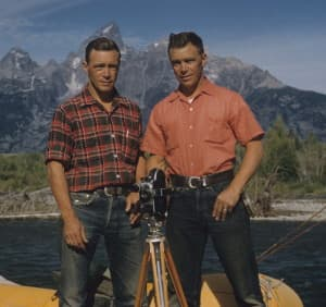 Frank and John Craighead in a raft in front of the Tetons. The twin brothers advanced biology by using radio telemetry to track grizzlies in Yellowstone. Grizzly bears weren't found along the Snake River when the brothers took this picture, but they populate the area today. (Craighead Institute)