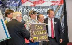 Sen. Leland Christensen, right, appeared in Casper at a rally supporting coal mining as he stumped the state as a candidate for the U.S. House of Representatives earlier this year. The White House has announced grants to offset impacts in coal country, including $450,000 for Western communities. (Tim Kupsick/WyoFile)