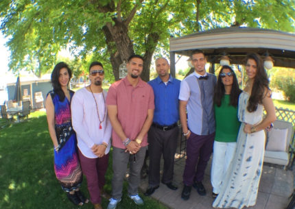 The Khans of Sheridan. Zarina Khan and her six children at her youngest son's graduation from high school this spring. (Courtesy of the Khan family)
