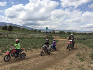 With kids under 16 unable to legal ride Forest Service roads, the Sander and Fischer families instead take to the popular Red Lake Trail near Cody. Dana Sander is among those who'd like to see more motorized trials — which do allow kids to operate their own machines — added to the Shoshone National Forest. (Photo by Dana Sander)
