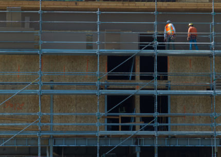 A scaffold and other gear protects construction workers on June 7 at the site of the new Marriott Hotel being built in Jackson. (Angus M. Thuermer Jr./WyoFile)