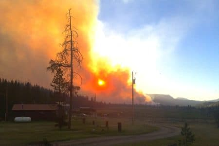 The sun turns red when seen through the smoke of the Lava Mountain Fire at the MacKenzie Highland Ranch near Dubois. The ranch is one of several evacuated this week because of the blaze. (Hector MacKenzie)