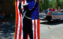 At the end if the Fourth of July parade in Jackson on Monday, a standard bearer with Jackson Hole Fire/EMS rolls up Old Glory. In a time of political turmoil and rapid change, Pete Simpson has some advice for those who would keep the flag of the republic flying.(Angus M. Thuermer Jr./WyoFile)