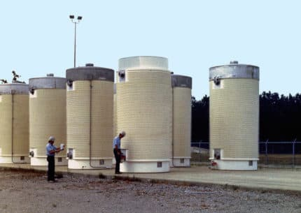 Highly radioactive waste from nuclear power plants are stored in cylindrical casks. Some Wyoming lawmakers say they're ready to consider taking part in a federal effort to build temporary and permanent storage for nuclear power plant waste. (U.S. Department of Energy)