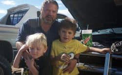 """James Whitten got laid off from the oil patch and is having a rough time making ends meet for his family, including sons Adam and Adrian. """"I got a sick feeling in my stomach when I saw gas at $1.60 a gallon,"""" he said. (Andrew Graham/WyoFile)"""