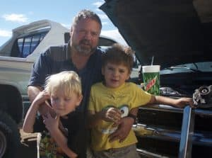 "James Whitten got laid off from the oil patch and is having a rough time making ends meet for his family, including sons Adam and Adrian. ""I got a sick feeling in my stomach when I saw gas at $1.60 a gallon,"" he said. (Andrew Graham/WyoFile)"