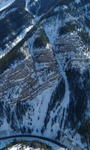The Cow of the Woods avalanche path looms above U.S. 191 in Hoback Canyon in this aerial photo, which also shows the smaller Calf of the Woods track. WYDOT has placed O'Bellx exploders in both paths so workers can provoke snowslides from afar. The new O'Bellx devices can be retrieved by a helicopter for maintenance or refueling. (WYDOT)