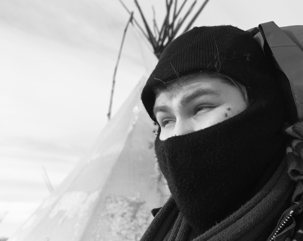 Micah Lott, who goes by the name Big Wind, stayed at the Oceti Sakowin Camp near the Standing Rock Indian Reservation until the end. His tipi was his winter quarters where he flew the Arapaho flag and worked with camp security. (Angus M. Thuermer Jr./WyoFile)