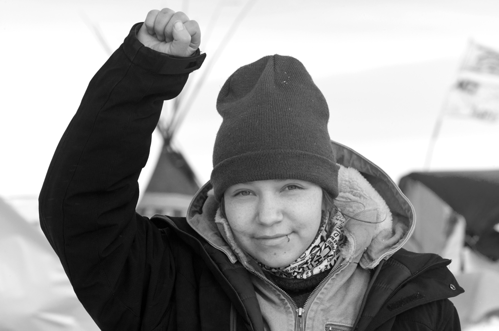 MyKennah Lott, known as Little Wind, was arrested at the Dakota Access Pipeline and charged with engaging in a riot. She has pleaded not guilty and faces a trial next year. She's filed a suit over her treatment at the hands of police. (Angus M. Thuermer Jr./WyoFile)