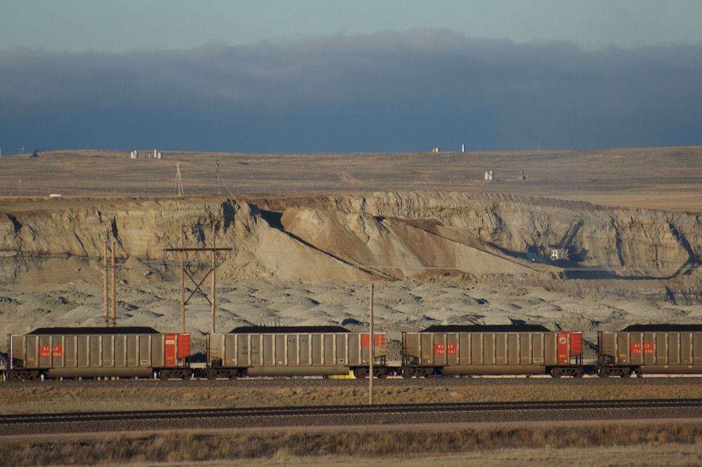 A coal train moves in front of the Black Thunder mine outside Wright in October. Activity picked up at the mines over the third quarter and into the fourth quarter of 2016. The upswing in mining increased coal train traffic. It has also led to some hirings at the mines, after 500 layoffs in the spring and more over the summer. (Andrew Graham/WyoFile)