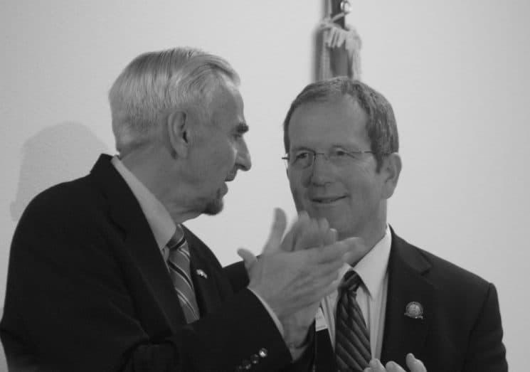 Senate President Eli Bebout and Speaker of the House Steve Harshman confer while applauding Gov. Mead's entrance to the House Floor on Jan. 11. (Andrew Graham/WyoFile)