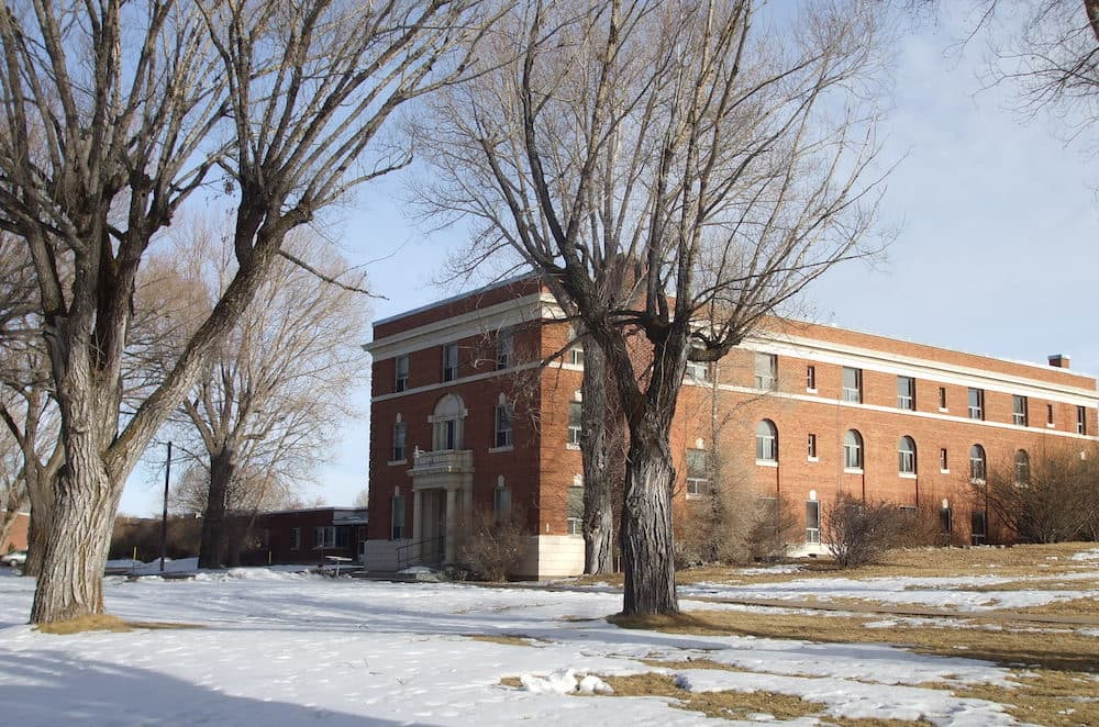 The Wyoming State Hospital in Evanston, once called the Wyoming Insane Asylum. Funding for some critical mental health services has run out, forcing the Department of Health to shift money from other services. (Tricia Simpson/Wikimedia Commons)