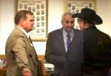 Sen. Leland Christensen speaks with Senate President Eli Bebout and Sen. Ogden Driskill after the Senate adjourned for the weekend Feb. 16. (Andrew Graham/WyoFile)