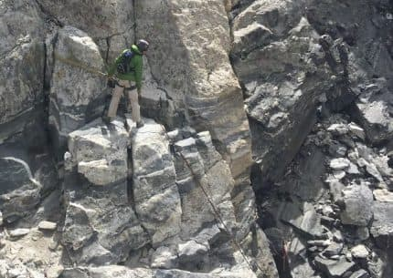 This photo of Owen-Spalding rappel station taken a few weeks after Gary Falk's death shows the point from which he fell. Falk was attached to the anchor slings with a four-foot tether and probably leaning out when his knot failed, rangers believe. (Grand Teton National Park)