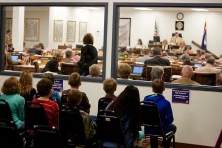 Fourth graders from Lingle Elementary school watch members of the House of Representatives discuss the nuances of the budget bill on Feb. 8. (Andrew Graham/WyoFile)